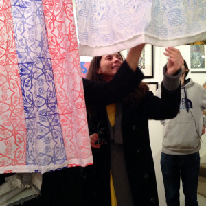Teaching staff from William Morris Sixth Form admire the printed textiles.