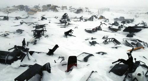 A skidoo graveyard in the remote arctic village of Ivujivik, Nunavik, Quebec, Canada, April 2006.