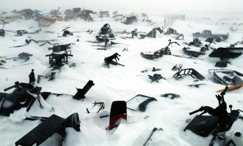 A skidoo dump/graveyard in the remote arctic village of Ivujivik, Nunavik, Quebec, Canada, April 2006. Contact with Western societies has meant that the Inuit of arctic Canada have largely given up the use of dog sleds as their main form of transport in favour of the less environmentally friendly skidoo. As the sea ice thins due to global warming accidents are becoming increasingly common as, unlike the team dogs who could smell salt water, the skidoo has no innate ability to know if the ice is safe to traverse. It also serves as a reminder of the vanishing Inuit culture which, some predict, will be gone within two generations.